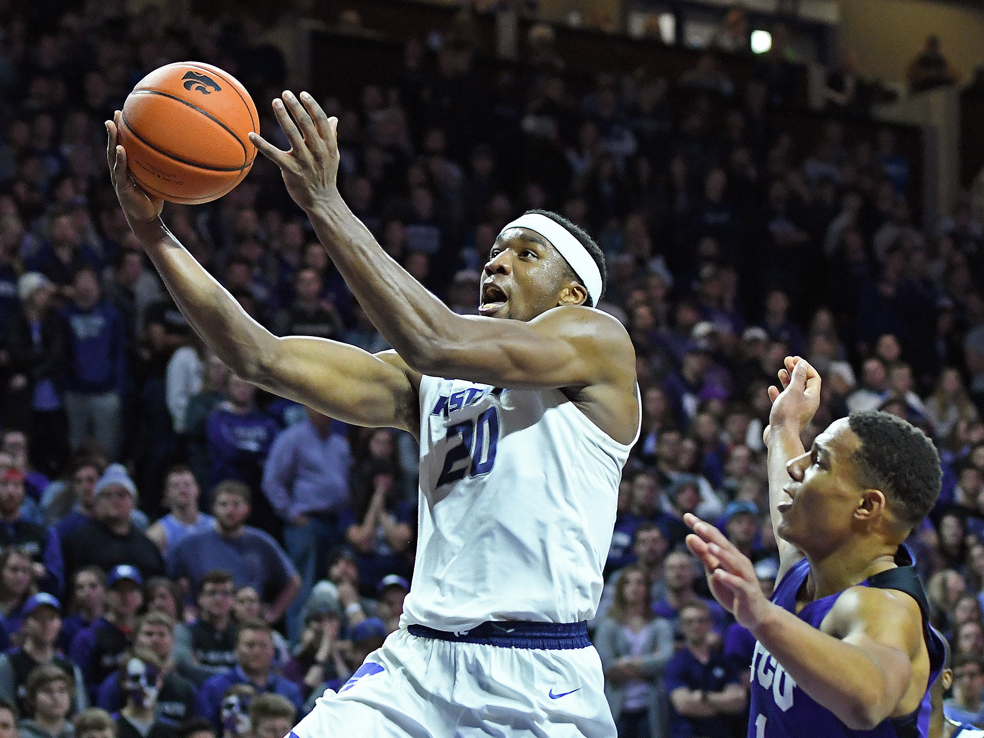16a59ab7b79 K-State s Xavier Sneed lays up a shot against TCU at Bramlage Coliseum in  Manhattan